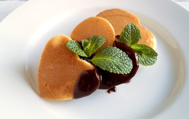Pancakes on valentine's day. on a white plate