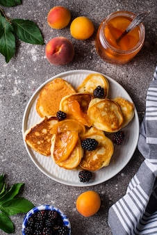 Pancakes with apricot jam and berry