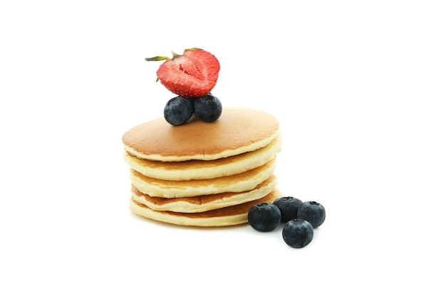 Pancakes with berries isolated on white background