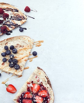 Pancakes with berries and syrup