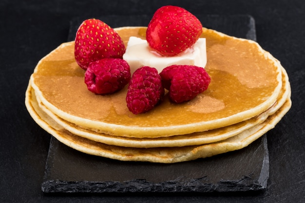 Pancakes with berry fruit and honey. selective focus
