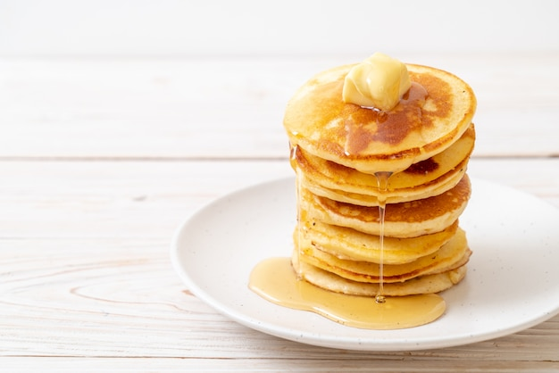 Pancakes with butter and honey