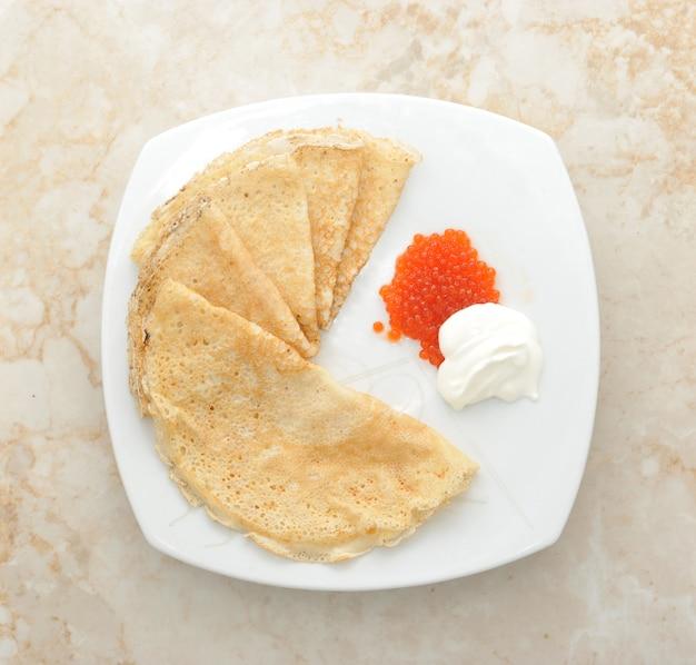 Pancakes with caviar