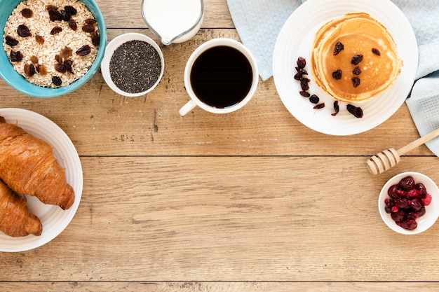 Pancakes with coffee croissants and copy space
