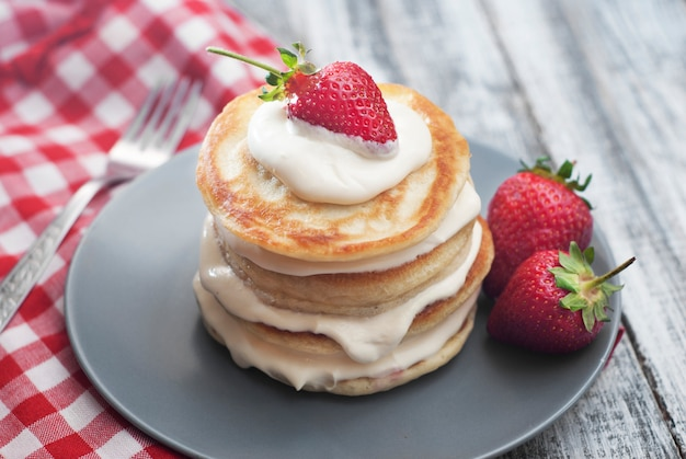 Pancakes with cream and strawbery. health breakfast.
