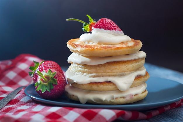 Pancakes with cream and strawbery