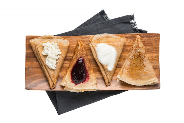 Pancakes with filling isolated on a white background