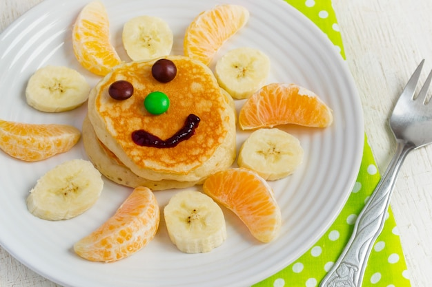 Pancakes with fruit and jam for the children. breakfast concept
