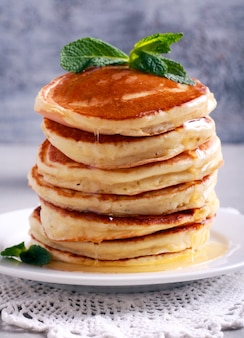 Pancakes with honey, served on a plate