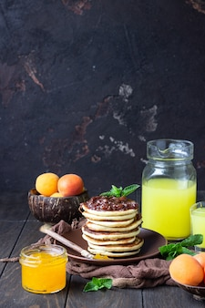 Pancakes with jam, apricot and mint. delicious dessert for breakfast.