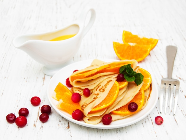 Pancakes with oranges and cranberries