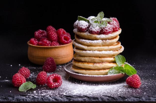 Pancakes with raspberries and berries around