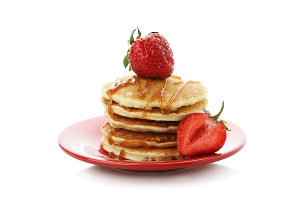 Pancakes with strawberry and caramel isolated on white background