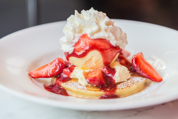 Pancakes with strawberry and ice cream