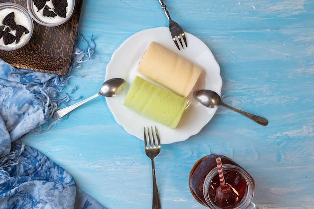 Pandan swiss roll cake and strawberry swiss roll cake