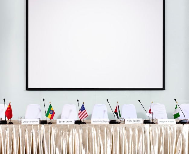 A panel discussion with empty seat
