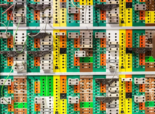 Panel with many colorful sockets.