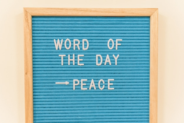 Panel with the phrase of the day, peace, to inspire children in a school to fight for peace.