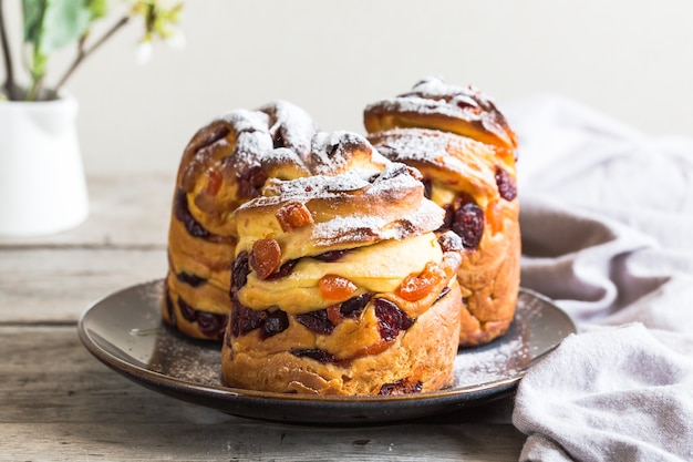 Panetone kulich craffin on wooden background. easter bread kozunak. copy space concept.
