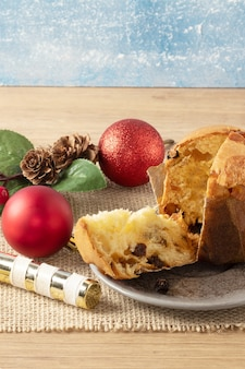 Panettone, christmas cake with decorative objects on the table. copy space.