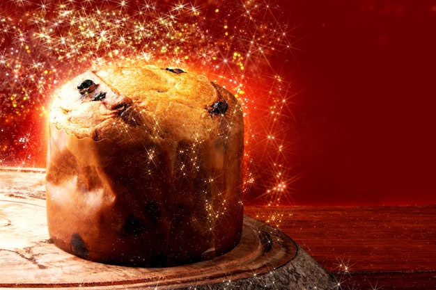 Panettone traditional italian dessert for christmas. background with defocused lights.