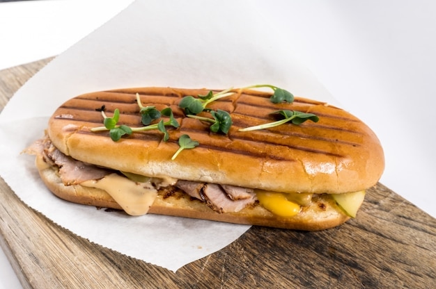 Panini with ham, cheese and soybean seedlings