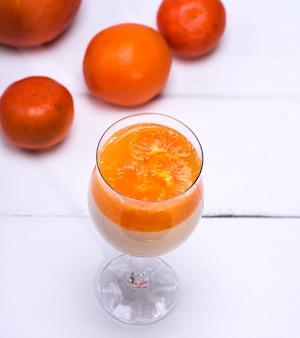 Panna cota  with tangerines in a glass beaker
