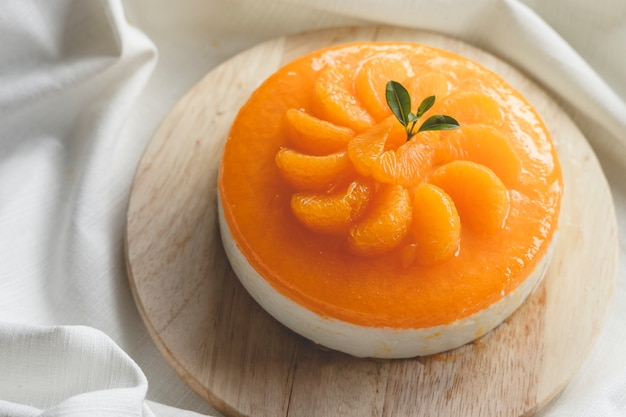 Panna cotta with tangerines and tangerine sauce.
