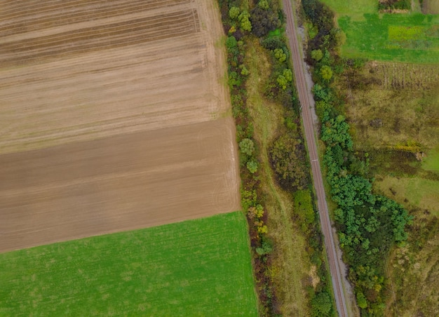 Panorama aerial top view of a different agriculture fields in countryside