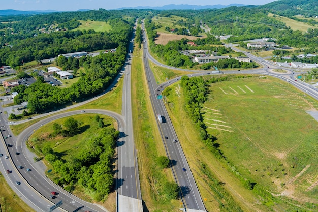 Panorama aerial view of highway intersection traffic road in daleville town with valley mountains