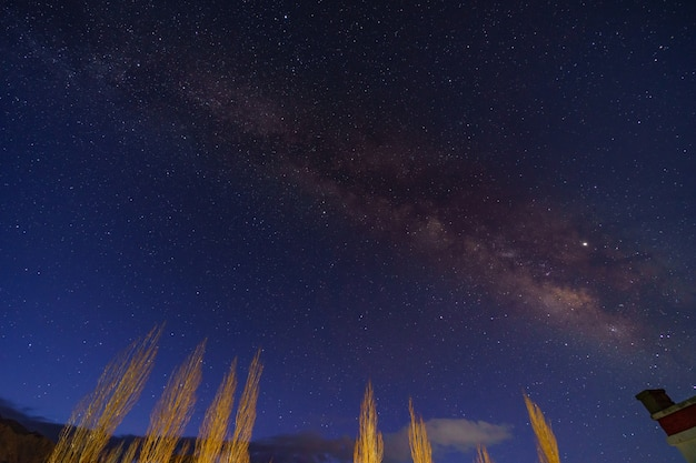 Panorama of arching milky way galactic center over the mountain at leh city, ladakh, india.