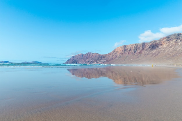 Panorama of beautiful beach and tropical sea of lanzarote. canaries.