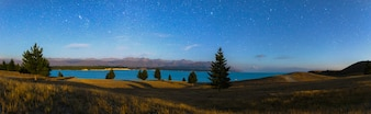 Panorama beautiful Night sky at Lake Pukaki with view mount cook as a background, New Zealand