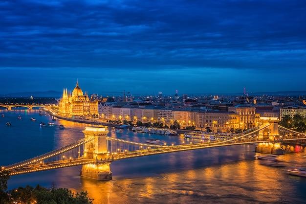 Panorama of budapest at night. hungarian landmarks: chain bridge, parliament and danube river in budapest.