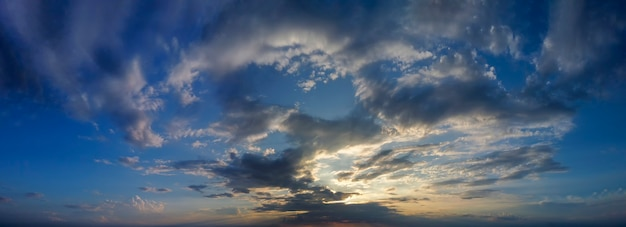 Panorama of dramatic twilight, sunset between clouds on the horizon.