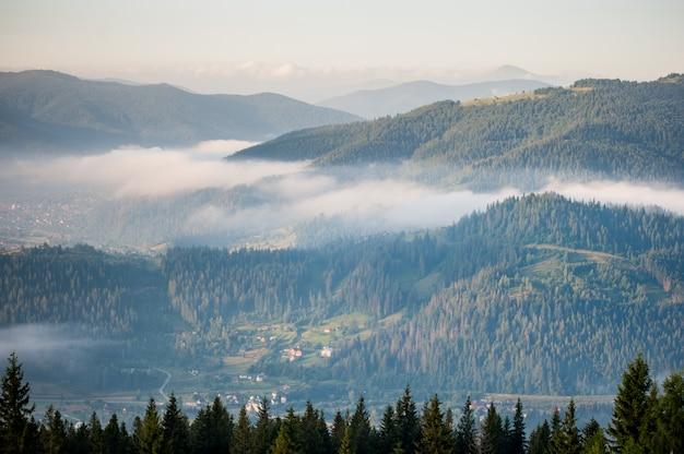 Panorama of foggy mountain range