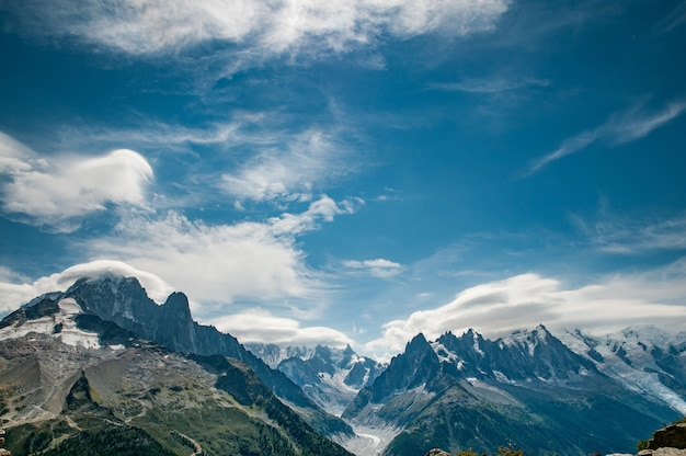 Panorama from aiguille verte to mont blanc with stunning cloudy blue sky