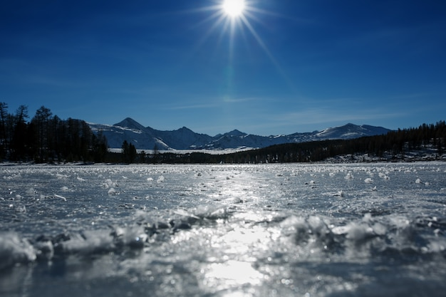 Panorama of frozen lakes, covered with ice and snow. in clear weather with a blue sky in the sunlight. altai.