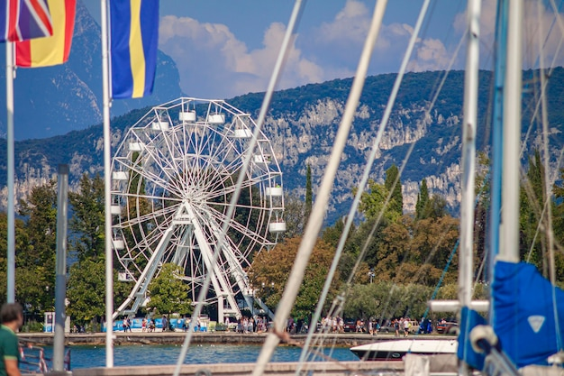 Panorama of garda lake in bardolino with ferris wheel during summer