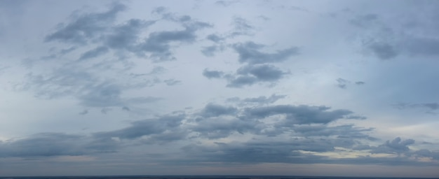 Panorama of gloomy autumn gray sky.