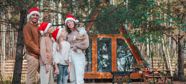 Panorama of happy family on christmas vacation outdoors