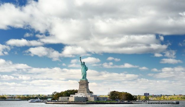 Panorama of island of liberty with statue of liberty seen from the ferry in the hudson river