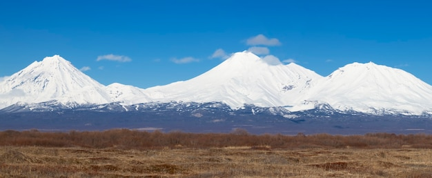 The panorama koryaksky avachinsky kozelsky volcanoes of kamchatka peninsula