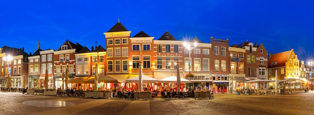 Panorama markt square with typical dutch houses in the center of the old city at night, delft, holland, netherlands