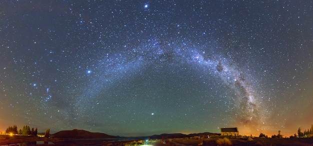 Panorama milky way at the church of the good shepherd, lake tekapo, new zealand