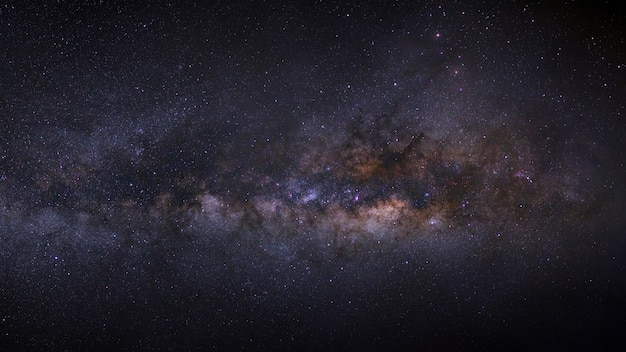 Panorama milky way galaxy on a night sky, long exposure photograph, with grain.