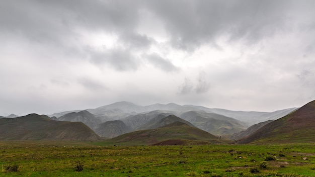 Panorama of mountains in rainy cloudy weather