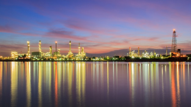 Panorama oil refinery along the river at dusk