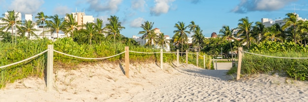 Panorama of pathway to the beach in miami florida with ocean background