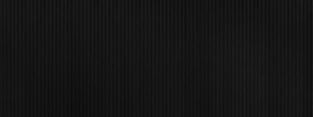 黒のメタリックテクスチャの詳細とシームレスな壁、グランジメタルスタイルの背景、コピースペースのパノラマ写真。